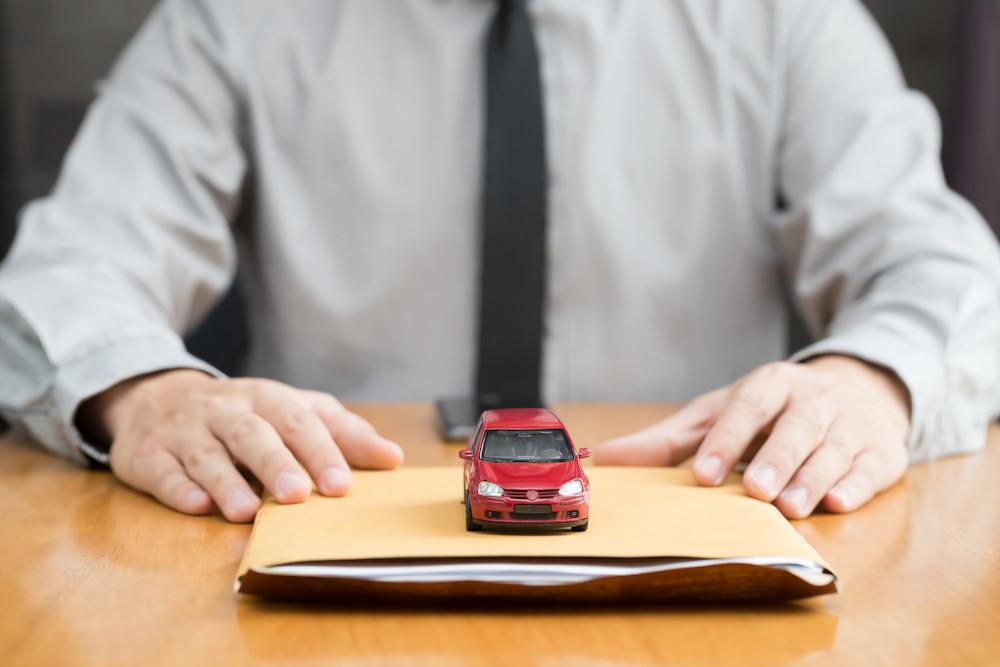 Toy car on a loan folder